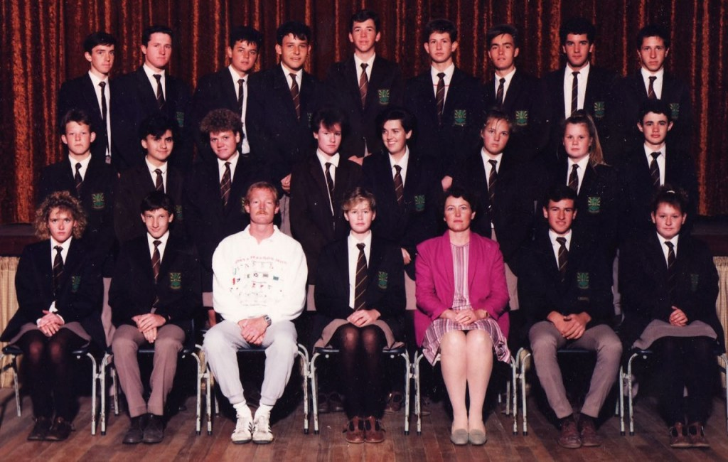 Just look for the most miserable face in the photo and you'll have found me. Clue: I'm standing behind the teacher in the pink jacket.