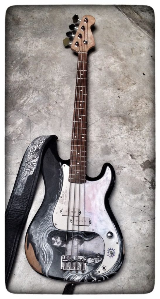 "This is our ""hero prop"" for the film. Nick got this old bass guitar for R500 (about $40). We messed it up some more and created artwork on it (referencing Edvard Munch, Jimmy Hendrix - and a few Hatty scribbles too). The producers reimbursed Nick the R500... the strap is from one of Nick's older guitars... and again - no money spent."